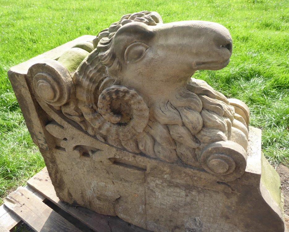 ONE Extremely Rare, Superb, Architectural, Hand-Carved York Stone 'Ram's Head' With Bobbin Mill Key Stone For Large Arch. Originated From A West Yorkshire Woollen Mill Entrance Arch. NOTE: The Turned Bobbin Which Is A Symbol Of The Yorkshire Woollen Industry Above The Head.